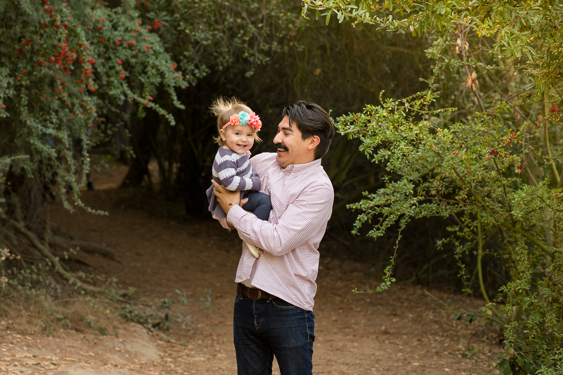 Baby girl laughs with her dad in the canyon