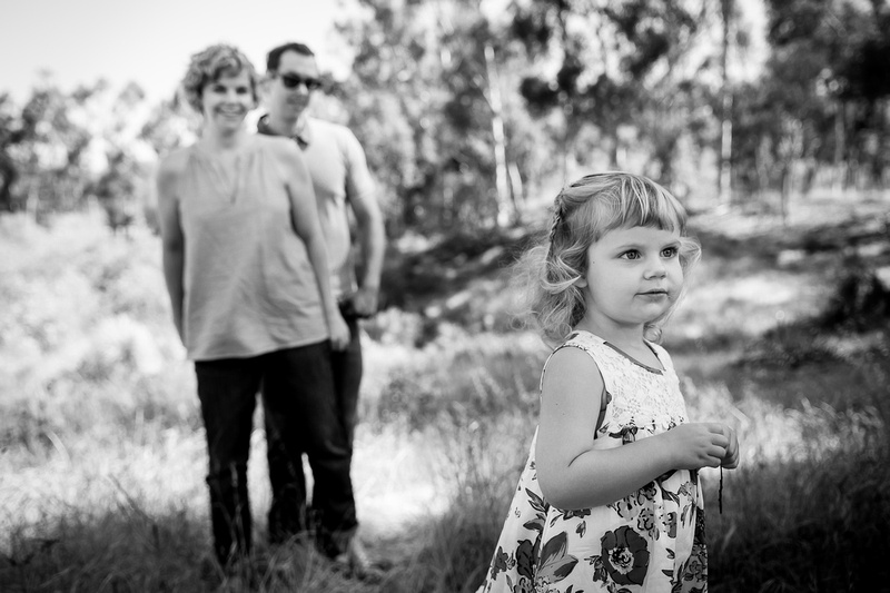 Family goes for a walk black and white portrait.